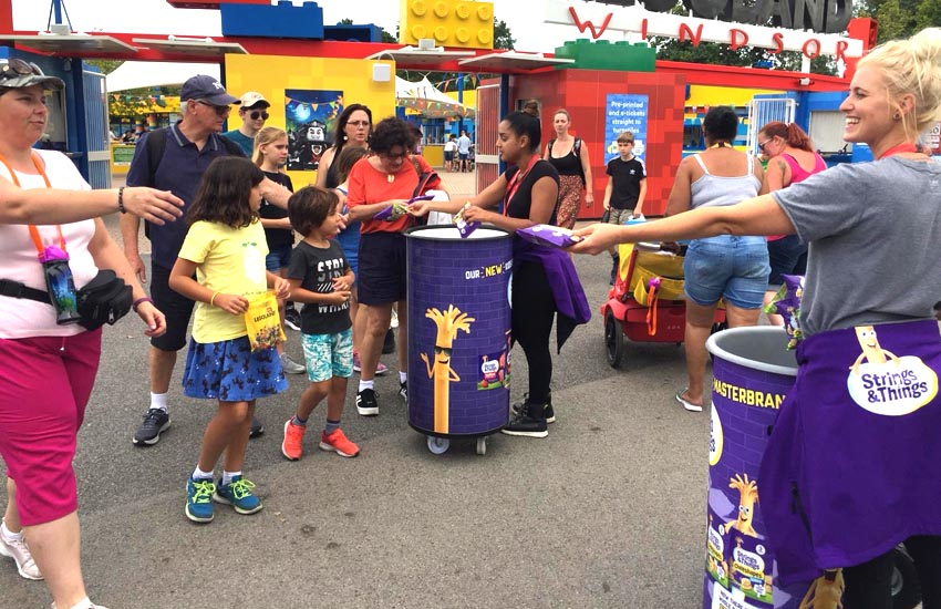 Hand to hand product sampling campaign at theme parks